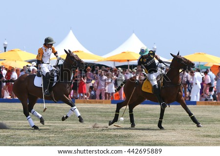 JERSEY CITY, NJ-MAY 30: Rico Mansur (R) handles the ball as Edward Hartman gives chase during a polo match at the Veuve Clicquot Polo Classic at Liberty State Park on May 30, 2015 in Jersey City, NJ. - stock photo