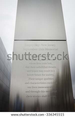 JERSEY CITY, NJ-SEP 10 2015: Inscription on the wall of Empty Sky, the official New Jersey Sept 11th memorial in Liberty State Park that lines up on the New York skyline where WTC towers once stood. - stock photo