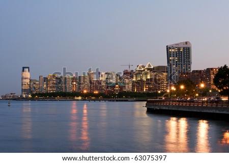 Jersey city skyline at dusk, New Jersey - stock photo