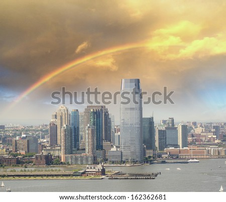 Jersey City skyline with Hudson river, aerial view with rainbow colors. - stock photo