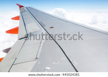 Jersey, UK - May 14: View through a window on the easyJet plane wing during a flight to the island of Jersey, UK on May 14, 2015
