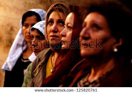 JERUSALEM - APRIL 08:Cristian women pray during Easter mass at the Holy Sepulchre on April 08 2007 in Jerusalem, Israel.The Church considered to be the holiest Christian site in the world. - stock photo