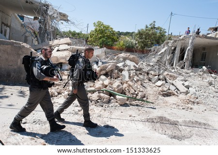 JERUSALEM - APRIL 24: Israeli border police guard the demolition of the Jaradat family home in the Al Tur neighborhood of East Jerusalem, April 24, 2013.