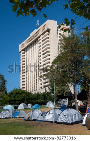 "JERUSALEM - AUGUST 11: A tent city pitched near a high-rise building as part of Israel's nationwide ""social justice"" protest movement occupies Jerusalem's Independence Park on August 11, 2011."
