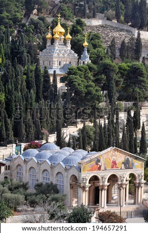 JERUSALEM  - DEC 12 2008:GChurch of All Nations and St. Mary Magdalene Church on Mount of Olives in Jerusalem, Israel.The Mount has been a site of Jewish and Christian worship since ancient times - stock photo