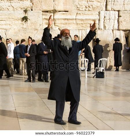 JERUSALEM - DECEMBER 09: An unidentified orthodox religious Jew prays near the Wailing Wall on December 09, 2007 in Jerusalem. - stock photo