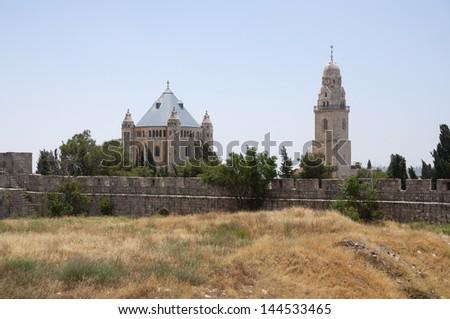 Jerusalem Dormition Abbey and the surrounding walls - stock photo