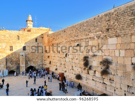 JERUSALEM - FEBRUARY 20: Jews pray at the wailing wall February 20, 2012 in Jerusalem, IL. The wall is the most sacred sites in Judaism outside of the Temple Mount itself attracting thousands daily.