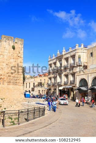 JERUSALEM, ISRAEL - APRIL 12: Entrance down the street from Jaffa gate to the old city of Jerusalem during the Jewish Pesach (Passover) on April 12, 2012 in Jerusalem, Israel - stock photo