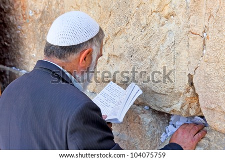 JERUSALEM, ISRAEL - APRIL 26: Jewish sitting and praying at the western wall on a jewish holiday Israel's 64th Independence Day on April 26, 2012 in Jerusalem, Israel - stock photo