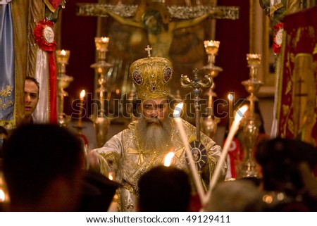 JERUSALEM, ISRAEL - APRIL 19: Patriarch of Jerusalem Orthodox church Feofil during Easter mass in the Church of the Holy Sepulcher April 19, 2009 in Jerusalem, Israel. - stock photo