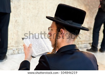 JERUSALEM, ISRAEL-APRIL 27: Unidentified Jewish praying at the western wall on a jewish holiday on April 27. 2012.Jerusalem, Israel.April 27. celebrated as day when the state of Israel was proclaimed - stock photo