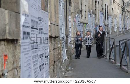 JERUSALEM, ISRAEL - CIRCA MAY, 2013 - Children in Mea She'arim district populated by Haredi Jews. - stock photo