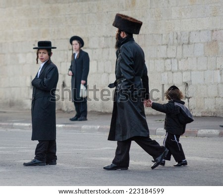 JERUSALEM, ISRAEL - CIRCA MAY, 2013 - Four of Jews walking and standing in the street of Jerusalem. - stock photo