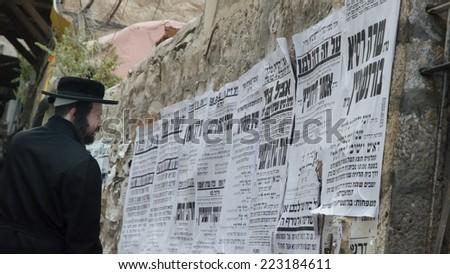 JERUSALEM, ISRAEL - CIRCA MAY, 2013 - Jew reads  pashkevilin (announcements) in Mea She'arim. - stock photo
