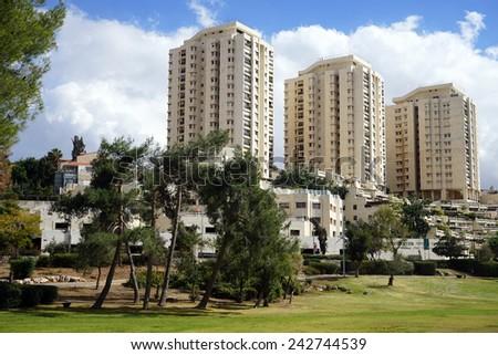 JERUSALEM, ISRAEL - CIRCA OCTOBER 2014 Modern buildings near park in Jerusalem, Israel                                - stock photo
