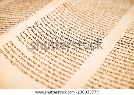 JERUSALEM, ISRAEL, CIRCA 2014. The Hebrew handwritten Torah, on a synagogue alter, illustrating Jewish holidays, during fests. Letters of scriptures close up. - stock photo