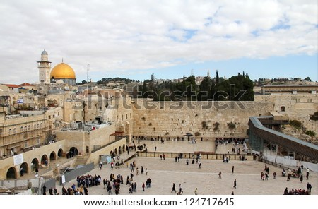JERUSALEM, ISRAEL - DECEMBER 19: Jewish worshipers pray at the Wailing Wall an important jewish religious site  on December 19, 2012  in Jerusalem, Israel - stock photo
