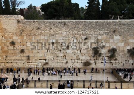 JERUSALEM, ISRAEL - DECEMBER 19: Unidentified  worshipers pray at the Wailing Wall an important jewish religious site  on December 19, 2012  in Jerusalem, Israel - stock photo