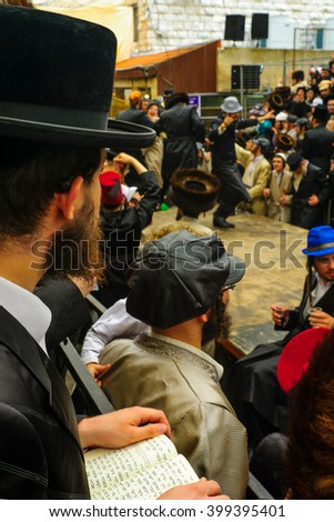 JERUSALEM, ISRAEL - FEBRUARY 25, 2016: Jewish man read a holy book, part of a celebration of the Jewish Holyday Purim, in the ultra-orthodox neighborhood Mea Shearim, Jerusalem, Israel - stock photo