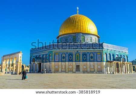 JERUSALEM, ISRAEL - FEBRUARY 16, 2016: The Dome of the Rock was faced in unusual manner - the lower part with white stone and the upper part with colorful glazed tiles, on February 16 in Jerusalem.