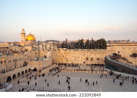 JERUSALEM, ISRAEL - JAN 24: Jewish worshippers pray at the Wailing Wall on Jan 24, 2011 Jerusalem, Israel. The wall is the most sacred site in Judaism outside of the Temple Mount itself.  - stock photo