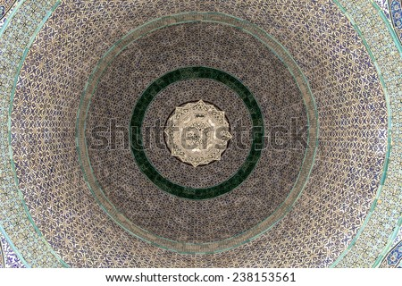 JERUSALEM, ISRAEL - JANUARY 29, 2013: A geometric pattern on the tiled ceiling of the Dome Of The Chain on the Temple Mount in the Old City of Jerusalem. The center part of the design is a chandelier. - stock photo
