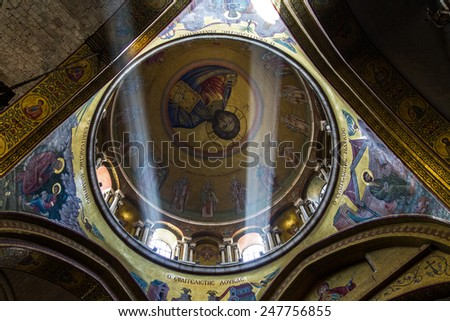 Jerusalem , Israel - January 22, 2015:  The Holy Sepulchre Church in the Old City of Jerusalem. Light goes through the dome of the church. - stock photo