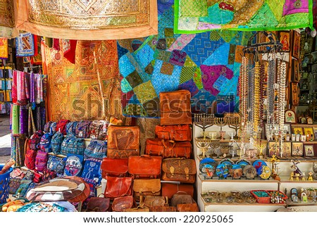 JERUSALEM, ISRAEL - JULY 10, 2014: Gift shop on bazaar in Old City of Jerusalem with variety of middle east traditional souvenirs. It is very popular with tourists and pilgrims visiting Holy Land. - stock photo