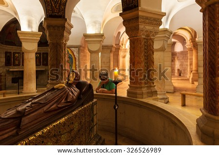 JERUSALEM, ISRAEL - JULY 16, 2015: Life-size statue of Mary in death made of cherry wood and ivory inside of Dormition Abbey - church on the site where the Virgin Mary is said to have died. - stock photo