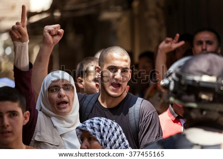 JERUSALEM, ISRAEL - JULY 26, 2015: Palestinians in Old City protest against ascent of religious jews to Temple Mount during Tisha B'Av - important annual fast day in Judaism. - stock photo