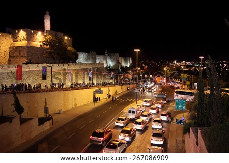 JERUSALEM, ISRAEL - JUNE 18, 2014:  Jaffa street and Tower of David at night - stock photo