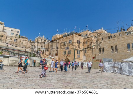 JERUSALEM, ISRAEL - JUNE 19, 2015: Tourists walking to the Western Wall, Wailing Wall or Kotel is located in the Old City of Jerusalem at the foot of the western side of the Temple Mount.