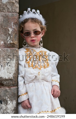 JERUSALEM, ISRAEL - MARCH 15, 2006: Purim carnival in the famous ultra-orthodox quarter of Jerusalem - Mea Shearim. Portrait of young girl dressed in a princess costume.