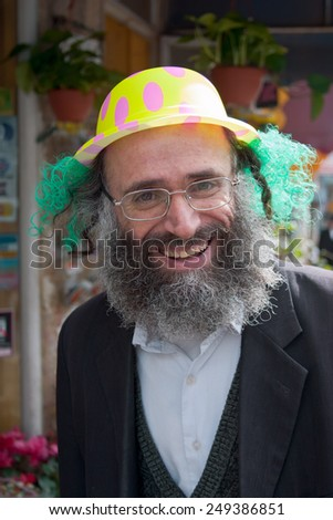JERUSALEM, ISRAEL - MARCH 15, 2006: Purim carnival in the famous ultra-orthodox quarter of Jerusalem - Mea Shearim. Portrait of  men dressed in traditional Jewish clothing. On his head wearing a cap.