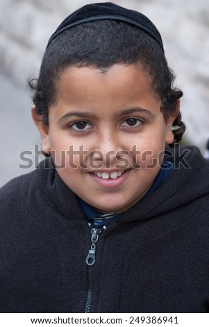 JERUSALEM, ISRAEL - MARCH 15, 2006: Purim carnival in the famous ultra-orthodox quarter of Jerusalem - Mea Shearim. Portrait of a boy children with a kippa on his head.