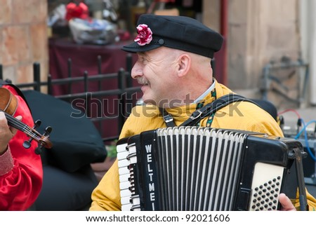 JERUSALEM, ISRAEL - MARCH 15: Purim carnival, unidentified street musician. March 15, 2006 in Jerusalem, Israel. Purim is celebrated annually according to the Hebrew calendar - stock photo