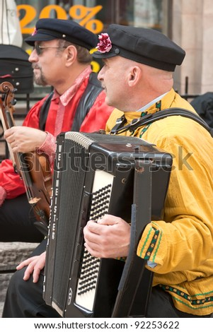 JERUSALEM, ISRAEL - MARCH 15: Purim carnival, unidentified street musicians. March 15, 2006 in Jerusalem, Israel. Purim is celebrated annually according to the Hebrew calendar - stock photo