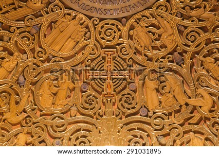 JERUSALEM, ISRAEL - MARCH 3, 2015: The relief of Jerusalem cross and Old Testament Scenes in Dormition abbey in apse of side chapel in upper church.