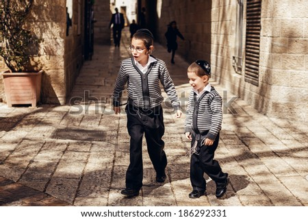 JERUSALEM, ISRAEL - MARCH 22, 2014: Two jewish kids in holy city Jerusalem on March 22, 2014, Israel - stock photo