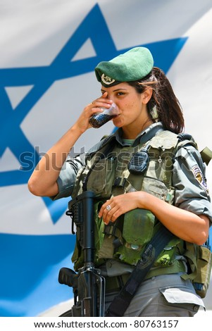 JERUSALEM, ISRAEL - MAY 30: Unidentified Israeli army girl at the Israel Expo, one of the largest celebration of Israeli culture on May 30, 2011 in Jerusalem, Israel. - stock photo