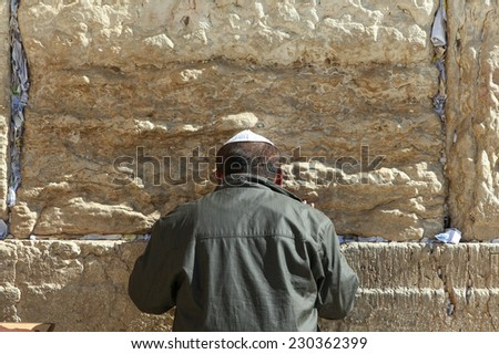 Jerusalem, Israel - November 9, 2014 : Jewish orthodox man pray at the western wall. The western wall is an exposed section of ancient wall situated on the western flank of the Temple Mount. - stock photo