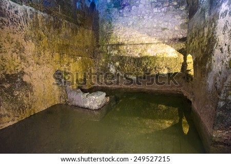 JERUSALEM, ISRAEL - OCT 07, 2014: The Struthion Pool is a large underground cuboid cistern beneath the Convent of the Sisters of Zion in the Old City of Jerusalem - stock photo