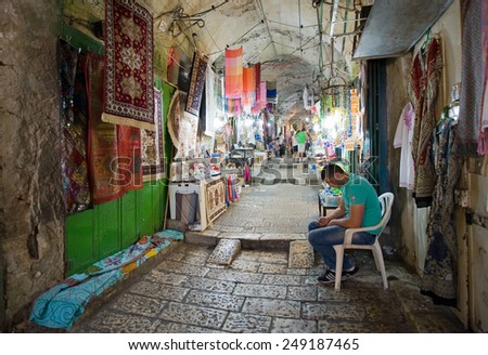 JERUSALEM, ISRAEL - OCTOBER 07, 2014: All kinds of shops in one of the small streets in the old city of Jerusalem - stock photo