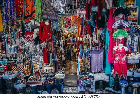 Jerusalem, Israel - October 22, 2015. Clothes, scarfs and souvenirs for sale on Arab baazar located inside the walls of the Old City of Jerusalem - stock photo