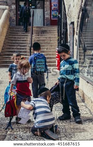 Jerusalem, Israel - October 22, 2015. Group of Jewish school kids on the street of Jewish Quarter - stock photo