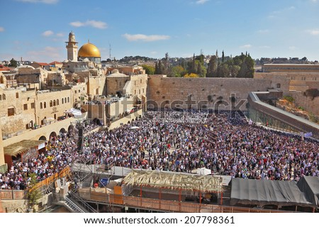 JERUSALEM, ISRAEL - OCTOBER 16, 2011:  The most joyous holiday of the Jewish people - Sukkot. The Western Wall in Jerusalem temple - stock photo