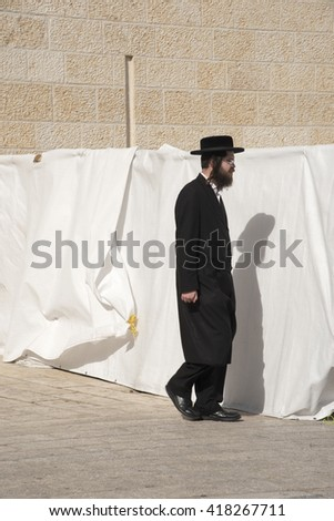 JERUSALEM, ISRAEL - OCTOBER 22 2015: Unidentified man  at the men's section of the Wailing (Western) Wall in the old town Jerusalem (Israel)