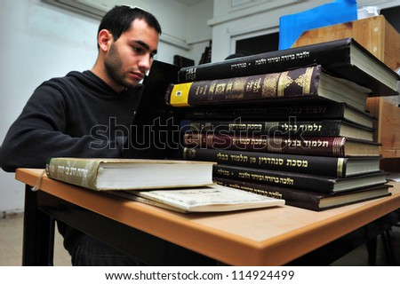 JERUSALEM-JANUARY 06:Israeli Jewish students learn Torah on Jan 06 2011 in Jerusalem, Israel.It is a program which combines advanced Talmudic studies with military service in the Israeli army. - stock photo