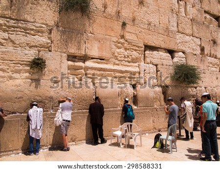 JERUSALEM - Juli 15: Jewish prayers and pilgrims beside Western Wall Juli 15, 2015 in Jerusalem, Israel. - stock photo